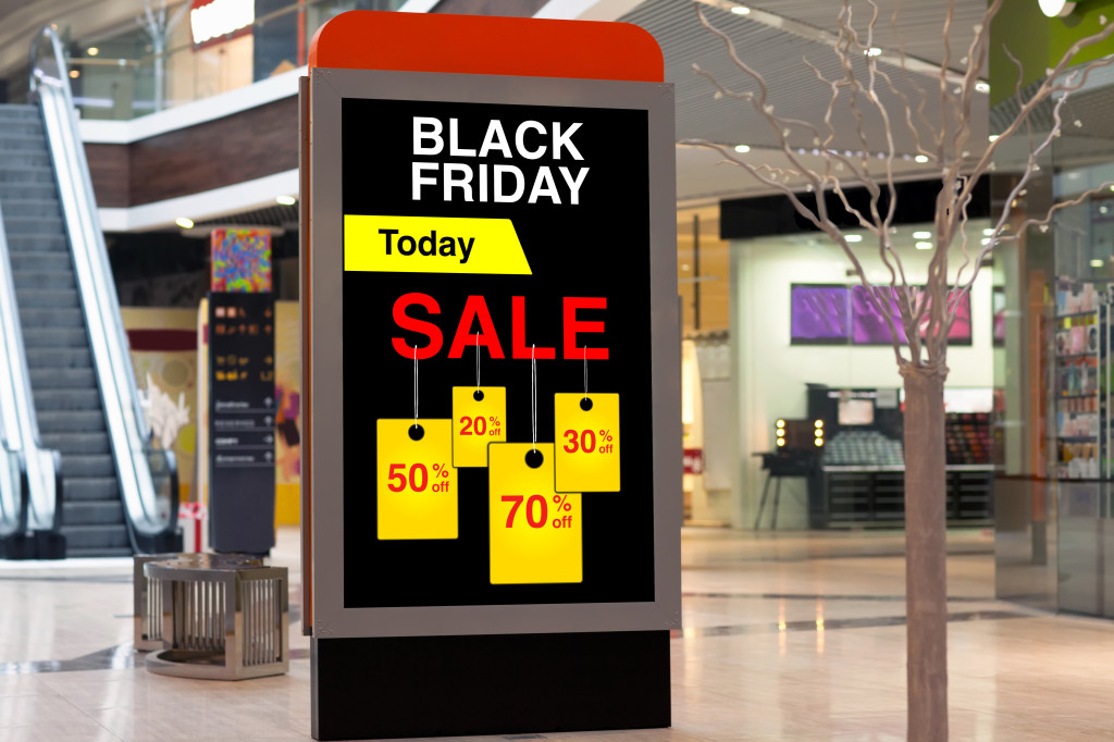 billboard advertising Black Friday and discounts in middle large